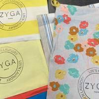 POCHETTES ZÉRO DÉCHET ♻️  Confectionnées à partir des surplus de tissus de nos collections, les pochettes ZYGA nous permettent d'emballer vos commandes avec douceur de manière responsable. Colorée, unie ou imprimée... Chaque pochette est tamponnée à la main par notre équipe.  Sac à linge, protection ou pochette à glisser dans la valise... Une fois votre colis reçu, détournez-la selon vos envies !  -- 🇬🇧 ZERO WASTE POCKETS ♻️  Made from the fabric surplus of our collections, ZYGA pouches allow us to softly pack your orders responsibly. Colorful, plain or printed... Each pouch is hand stamped by our team members.  Laundry bag, protection or bag to slide in the suitcase... Once your package is received, turn it away according to your wishes!   #ZYGAParis #WithLove #ModeResponsable #FashionRevolution #ModeAutrement  #SlowLife #TakeCareOfThePlanet #Fabrics #TissusPremium #PremiumFabrics  #LinenLovers #JaimeLeLin #Color  #SustainableFashion #ZeroDechet #SlowSewing #Couture #DIY #Upcycling #CousuMain #PackedWithLove
